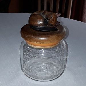 Glass canister with carved wooden cat top